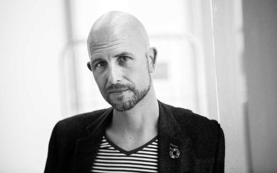 Dagvoorzitter en presentator Lars Sorensen